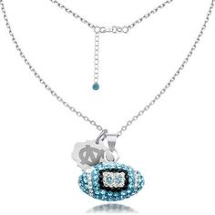 University of North Carolina Crystal Football Pendant - Item 19353408   REEDS Jewelers - Get ready for game day with this officially licensed University of North Carolina football pendant in sterling silver. The football pendant is adorned with Carolina blue, black and clear crystals and is 17mm in length and 16mm in width. An oval hang tag with the University of North Carolina 'UNC' logo hangs next to the football.
