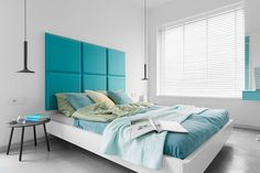 Bedroom Design Ideas - 8 Ways To Decorate The Wall Above Your Bed | Oversized Headboard -- Using a large headboard fills empty space, can add a pop of color to the bedroom, and makes reading in bed a little more comfortable.