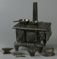"""""""Little misses in the first decades of the twentieth century were expected to learn how to cook for a household, so they needed something to practice on—something real. The Queen, a cast-iron and tin baby stove from 1915, burned coals or wood in its belly, while this lime-green metal toy stove from 1930 plugged into the wall. Both stoves had open burners, just like Mom's."""" scary!"""