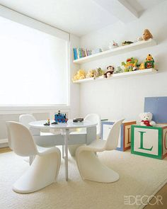 Panton Junior chairs by Vitra surround a glossy white table in this ultramodern boy's room.