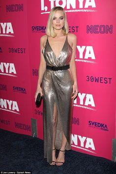 Gorgeous movie star: Margot donned strappy black heels, adding her delicate diamond wedding ring