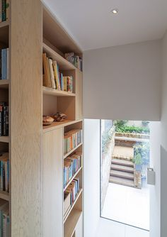 Moxon Architects added a new top floor to the house and a rear extension on the lower ground floor to increase the total volume by more than a quarter.