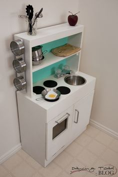 The Dancing Toad Blog: DIY Play Kitchen- stove top burners are coaster spray painted black.