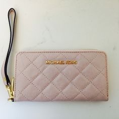 """MICHAEL KORS pinky wallet Vintage pink lamb leather quilted surface, with one open handle. Beautiful gold hardware details LOVE LOVE LOVE!!!!! Brand new, I had the tags but I lost it. So NO TAG, but BRAND NEW!!!!!!!  7""""x3.5x1""""  accepting ️️ Michael Kors Bags Wallets"""
