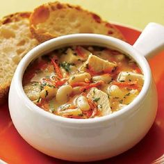 Slow cooker Tuscan chicken stew. Cubed chicken breasts with vegetables and dry white wine cooked in slow cooker.This delicious chicken recipe belongs to Italian cuisine.Serve with crusted bread over cooked rice or pasta.