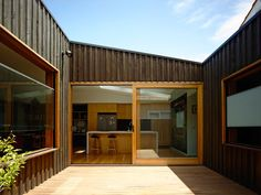 Batten and Board House: A Simple 'Box' Transforms a Weatherboard