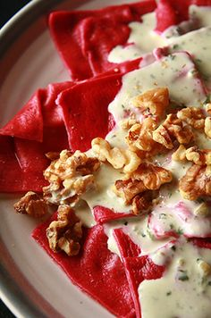 Beet and Goat cheese ravioli with basil cream sauce.