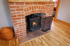 Wood burning stove at this Suffolk holiday cottage - Castle View Cottage, Bungay