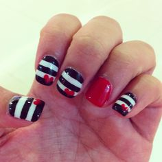 What's black and white and red all over?♥