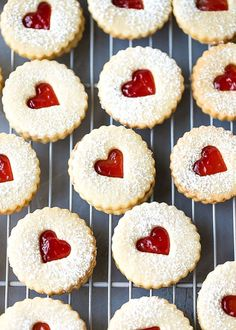 Easy Almond Linzer Cookies Recipe, round cutout cookies, sandwiched together with strawberry jam, placed on a drying rack. Holiday Cookie Recipes, Easy Cookie Recipes, Jam Recipes, Holiday Cookies, Holiday Baking, Christmas Baking, Dessert Recipes, Summer Cookies, Valentine Cookies