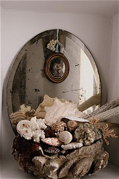 mirror and shells...and yes, look for vintage mirrors at your local Goodwill and then, let your creative muse go wild!