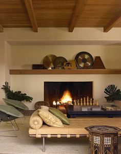 The trick to finishing a room is to organize accessories around similar colors and to display like objects with like objects, according to landscape designer Jay Griffith. On this living room mantel, he grouped several musical instruments together because they share both a similar rustic quality and earth tones.