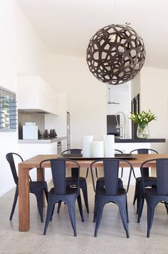 David Trubridge Coral Pendant Paint in a matt black/brown with matt blue Tolix chairs in a neutral dinning room.