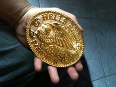 You can currently get this buckle in gold or silver on eBay for $150. However, like ALL bootleg Hells Angels gear (like the rockers, mouse pads, and t-shirts with the death's head you sometimes see), the seller is in Indonesia and has 0 feedback. Buyer beware; you'll probably get ripped off, and if you don't and an Angel sees you wearing it say goodbye to your teeth. http://www.ebay.com/itm/Motorcycle-Gang-Hell-Angel-Buckle-/321071848517?pt=LH_DefaultDomain_0=item4ac15f9c45