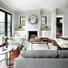 Living room-Gorgeous natural light, with clean neutral walls and molding. Yes please!