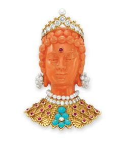 A CORAL, DIAMOND AND MULTI-GEM 'BODHISATTVA HEAD' BROOCH, BY CARTIER