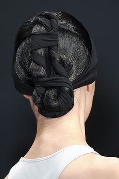 Wrap your ponytail with a black headband and twist it up for a cool, easy updo.  Um no.