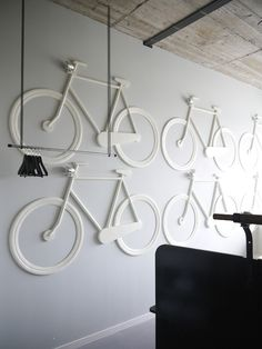 White Bike Room in the Volkshotel, Amsterdam. Everything in the room is bicycle. There is no cabinet, but bicycle bags on the wall. Lighting by bicycle lamps. You sleep in a carrier bicycle. Designed by: Thijs van Oostveen Pimp Your Bike, Bike Room, Bicycle Art, Bike Storage, Retail Space, Wall Treatments, Retail Design, Interiores Design, Store Design