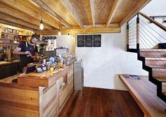 coffee counter is actually below grade Flipboard Cafe / Brolly Design