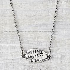 "A petite necklace that reads "" while I breathe I hope"" on the front with a butterfly on the back. Shop more of our inspirational handmade jewelry>>www.islandcowgirl.com"