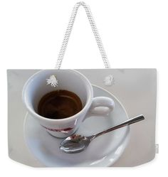 """A Cup Of espresso Weekender Tote Bag (24"""" x 16"""") by Marina Usmanskaya.  The tote bag is machine washable and includes cotton rope handle for easy carrying on your shoulder.  All totes are available for worldwide shipping and include a money-back guarantee.  White cup of Espresso.   By tradition in Italy morning begins with an espresso or cappuccino cup.  #MarinaUsmanskayaFineArtPhotography #HomeDecor #FineArtPrints #ArtForHome #Espresso"""