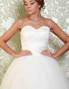 LINDSAY An elegantly simple ballgown style dress, the Lindsay features a beautiful sweetheart neckline, a satin sash at the waist and cross over detail that adorns the bodice. https://www.wed2b.co.uk/vintage-wedding-dresses/viva-bride-lindsay.php