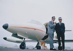 Frank Sinatra prepares to board his Learjet with friend Dean Martin, photographed by John Bryson, 1965