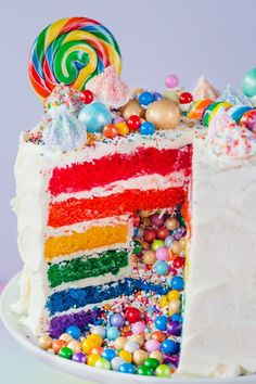 "How To Make the Ultimate Rainbow Surprise Cake. Maybe you've seen cakes like this on Pinterest, your favorite baker's Instagram feed, or even IRL at your best friend's house and thought to yourself, ""That cake looks so fun and complicated; I could never make that."" I'm here to encourage you otherwise! You can totally make this knock-out, show-stopping surprise-inside rainbow layer cake from scratch."
