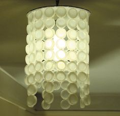 Why throw away plastic bottle caps when you could use them to create something beautiful and new?