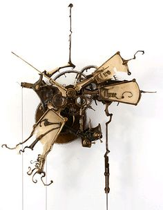 Steampunk clock by sculptor Eric Freitas. His work is out of this world good.