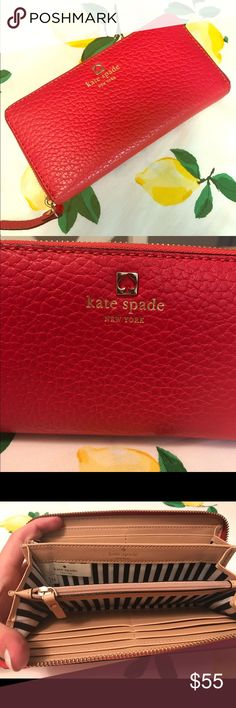 Kate Spade red wallet This is an adorable Cobble Hill pebbled leather Kate Spade wallet. It has many compartments for cards, receipts, coupons, change and even a check book! Cute black and white striped pattern on the inside. The zipper zips around the entirety of the wallet. Only used a handful of times. In wonderful condition! kate spade Bags Wallets