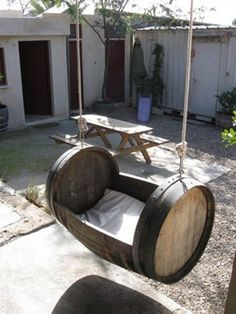 OOOOH I need to find a wine barrel. Wine Barrel Projects … This is so cute! Who'd have thought you could repurpose a wine barrel into a swing? Diy Swing, Diy Hammock, Hammock Ideas, Hammocks, Porch Swing, Barrel Furniture, Outdoor Furniture, Outdoor Decor, Outdoor Baby