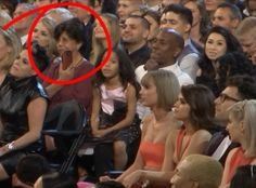 This woman sneakin' a pic of Taylor Swift. | 16 Moments From The Grammy Audience Cam You Didn't See On TV