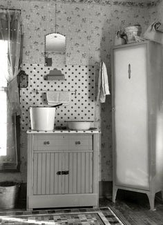 December 1936. Washstand in house occupied by married hired hand and his wife. Harry Madsen farm near Dickens, Iowa.