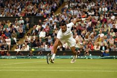 Jo-Wilfried Tsonga dives for a volley - Billie Weiss/AELTC