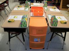 Color-coded bins and shower caddies. To top it off, there's a desk in the center that acts as a table top! Awesome!