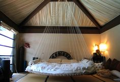 Love the idea of a hanging bed!