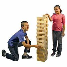 """Eco-friendly pine wood block tower game.  Product: Tower game setConstruction Material: Recycled pine woodColor: Natural Features:  Build team work while having fun with this classic game58 Lightweight blocksDimensions: Block: 2.75"""" W x 8.5"""" D eachOverall:  60"""" H x 18"""" W x 18"""" D"""
