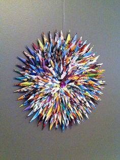 We have a lot of picture books in our Paper MakerSpace that you could turn into a colorful wreath like this!