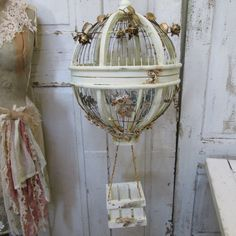 Huge hot air balloon birdcage rusted hand painted cream detailed with antique gilded rose fragments metal rusty roses vines  anita spero