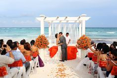 Riviera Maya Wedding at Grand Palladium Resort, beautiful ceremony set up on the beach. The floral arrangements are stunning!  Mexico wedding photgraphers Del Sol Photography