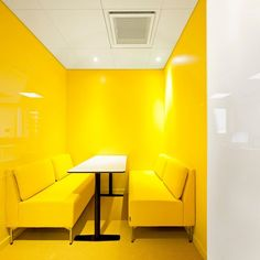 Yellow! Kährs, interior design, breakfast nook, kitchen design, yellow walls, white and yellow, yellow couch
