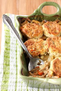 Craving pot pie? Chicken Pot Pie Casserole topped with homemade bacon cheddar biscuits is a great alternative when you don't want to make a pie crust.