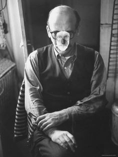 Saul Steinberg wearing a mask at a party in the home of Alexander Calder.