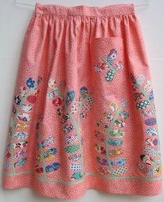 Apron with vintage petal quilt pieces.