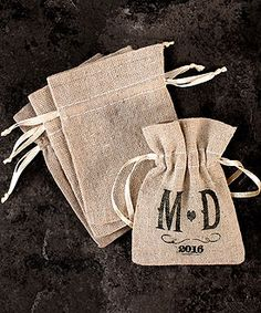 These mini linen drawstring pouches are simply lovely . Their rustic charm will be the perfect complement for any country or vintage theme wedding. A quick and simple way to wrap up a small treat to create a wedding favor your guests will enjoy receiving. Ideal for DIY brides interested in rubber stamping with a custom design.
