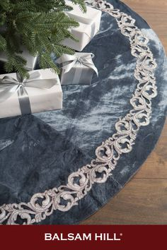 Give presents a plush and elegant backdrop with our French Blue Tree Skirt. Velvet fabric in a deep azure hue with glints of grey is accented by metallic acanthus appliqués for an opulent display with a hint of shine. #BalsamHillUK #ChristmasDecor #ChristmasTree #ChristmasIdeas #ChristmasStocking #ChristmasDesign #HomeDecor #Interior #InteriorDesign #Home #Design #Fall #Autumn #Inspiration #Wreath #Garland #UK #Ireland Blue Tree Skirt, Realistic Christmas Trees, Christmas Tree Accessories, Slim Tree, Balsam Hill, Tree Shapes, Fabric Covered Button, French Blue, Acanthus