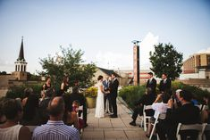 Erinn and Ryan's 70 guest roof top wedding at the Madison Museum of Contemporary Art. Photography by Katie Ricard. See more @intimateweddings.com #rooftopweddings #realwedding