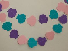 She sells seashells by the seashore! This colorful seashell garland is perfect for a mermaid birthday party or your seafaring little ones room! The