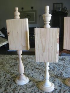 At Craft Stores- Glue wood plaques to wood candlesticks, glue finial on top. Paint finial and base a color to match kitchen or use in a kids bedroom.Then apply chalkboard paint to plaque- you put daily menu on or you can make it seasonal- You could draw J-O-Y and pinecones for Christmas, Monogram initials, etc., etc... How fun!!
